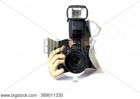 The Camera Looks Out Of The Hole In The Paper, The Concept Of Yellow Press, Paparazzi And The Fixing