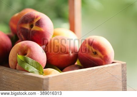 Fresh Sweet Peaches In Wooden Crate Outdoors, Closeup