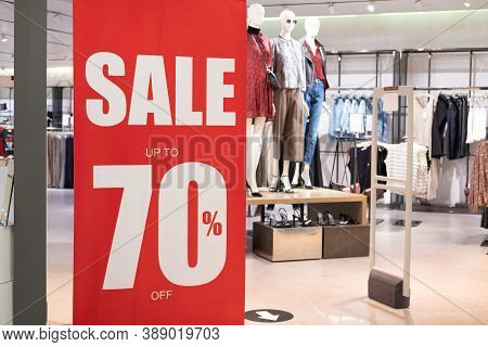 Big Red Sale 70% Sign To Draw Attention Of Customer In Front Of Women Clothing Store. Year Of End Or