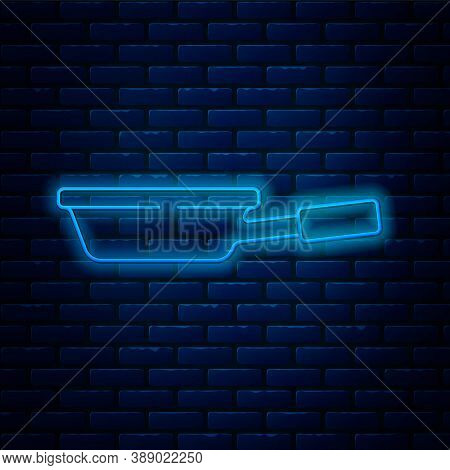 Glowing Neon Line Frying Pan Icon Isolated On Brick Wall Background. Fry Or Roast Food Symbol. Vecto