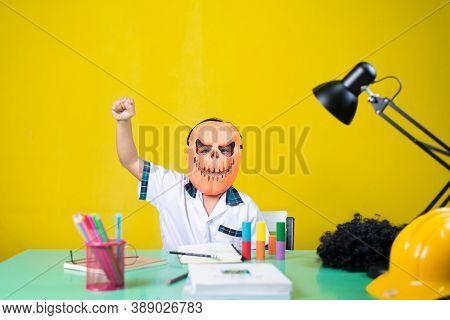 Child Wearing A Devil Mask, Look Happy, Homework Desk.