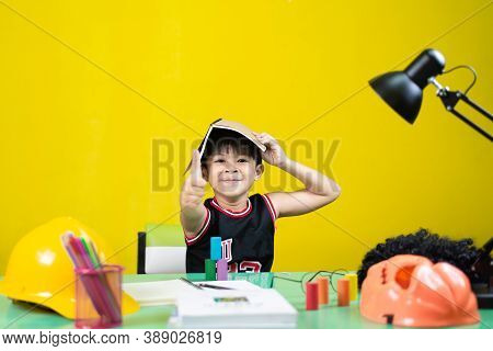 Children Doing Homework, Look At The Camera, At The Desk.