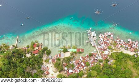 Aerial View Of Village Of Fishermen With Houses On The Water, With Fishing Boats, Samal Island. Phil