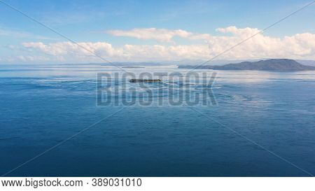 Tropical Islands In A Blue Sea Against A Blue Sky With Clouds. Mindanao, Philippines.