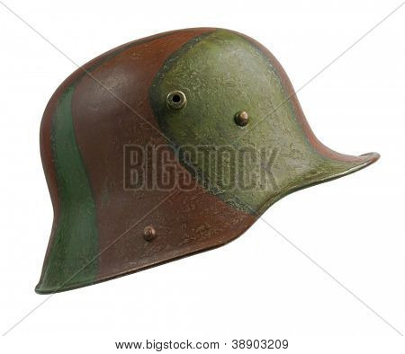 A German World War One (Stahlhelm M1916) military helmet, with camouflage paint. The Stahlhelm made its first appearance at the Battle of Verdun in 1916, but camouflage was not introduced until 1918.