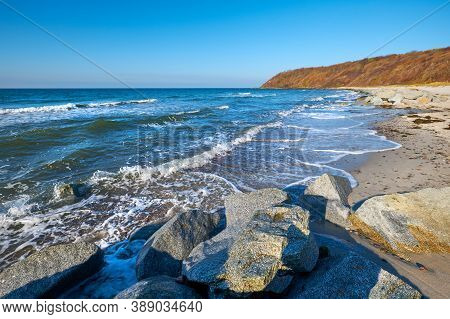 Stones Protecting Sand On Beach Near Kloster On Island Hiddensee, Germany In Autumn Or Winter.
