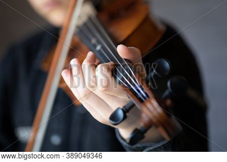 Close-up Of A Person Playing The Violin