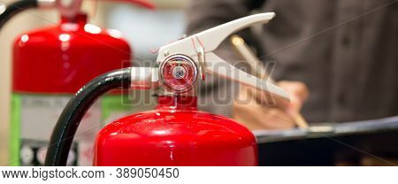 Fire Fighter Are Checking Pressure Gauge Of Red Fire Extinguishers Tank In The Building Concepts Of