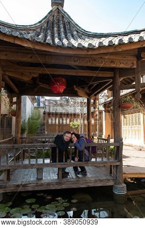 February 2019. Shaxi. Italian Tourists Visit The City. Halfway Between Dali And Lijiang, Between The