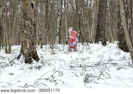 Children Play Outdoors. Adorable Little Girl Playing In Winter Park For Christmas Mood