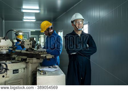 Industrial Worker Working At Factory,metal Lathe Industrial Manufacturing Factory.