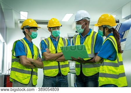 Group Industrial Worker Wear Protective Face Masks For Safety Working At Industrial Factory.