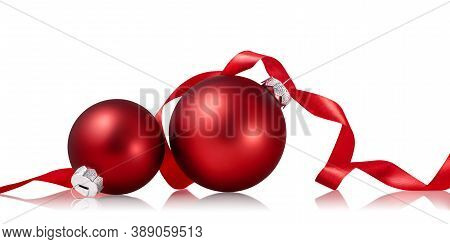 Red Christmas Baubles With Ribbon Isolated Over White Background. Holiday Ornament, Winter Decoratio