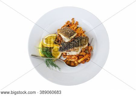Roasted Codfish On Cajun Pasta With Red Pesto, Orange, Lemon And Dill Garnish On A White Plate, Isol