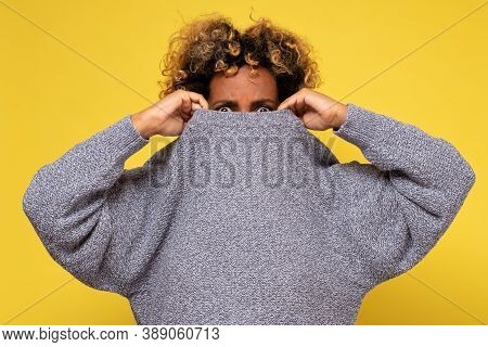 Displeased Young Afraid Woman Wearing A High Neck Sweater, Hiding Form Problems.