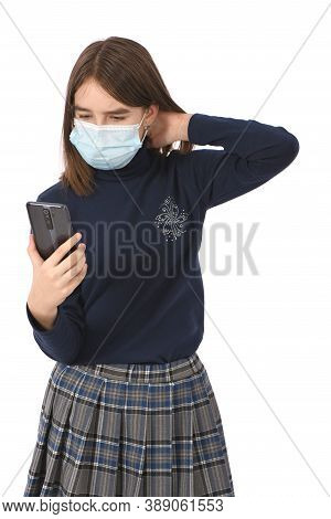 Pre-adolescent Girl Holding Black Smartphone. Isolated On White Background. High Resolution Photo. F