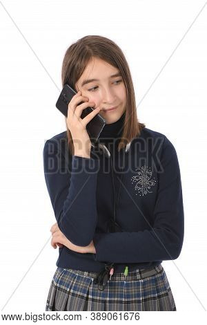 Pre-adolescent Girl Called On Black Smartphone. Isolated On White Background. High Resolution Photo.