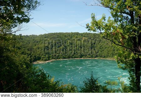 Green Dense Forest, Rough River, Strong Current, Cliff Sunny Day