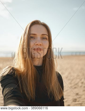 Beautiful Woman With Long Hair, Blonde Taking Selfie On Mobile Phone On Sandy Beach In Summer