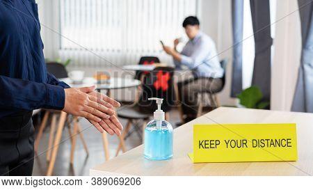 Woman Pressing Sanitising Hand Alcohol Gel Into Hand For Outbreak Prevention Coronavirus (covid-19)
