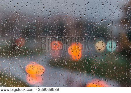Drops On Glass In Rainy Day. Rain Outside Window In The Town. Texture Of Raindrops, Wet Glass. Rainy