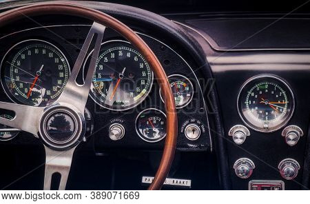 Part Of The Interior Of An Oldtimer Luxury Sports Car With Steering Wheel, Speedometer, Fuel, Clock