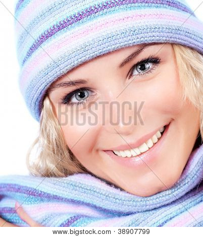 Happy girl in winter hat, beautiful young female wearing knitted warm wintertime clothing, expressing positive emotions, cheerful model, close up on pretty woman face, Christmas fashion