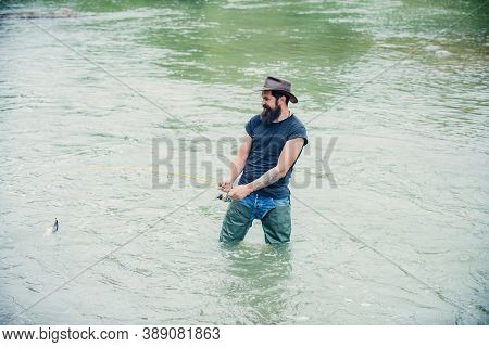 Bearded Fisher In Hat With Fish. Fishing Is Fun. Portrait Man On Holiday. Weekend. Summer Weekends O