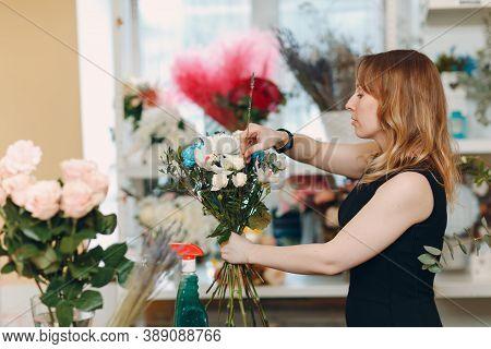 Florist Woman Make Bouquet In Flower Boutique