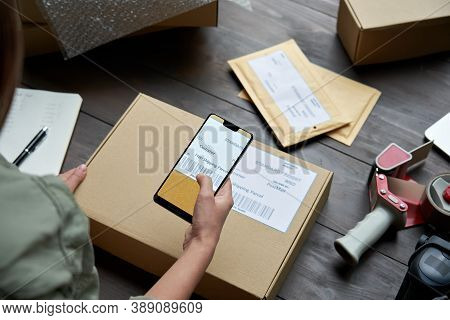 Female Warehouse Worker, Seller, Dropshipping Small Business Owner Holding Phone Scanning Retail Pac