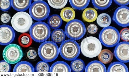 Top View Of The Background Of Aaa Aa Batteries And Rechargeable Batteries. Choice Of Batteries. Ener