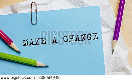 Make A Change Text Written On A Paper With Pencils In Office