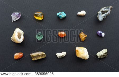 Composition Of Gems, Crystals And Minerals Of Different Geological Rocks On A Black Background. A Co