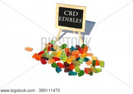 CBD Edibles. Gummy Candies filled with CBD or THC. Isolated on white. Room for text. Chalk Board Reads CBD Edibles.