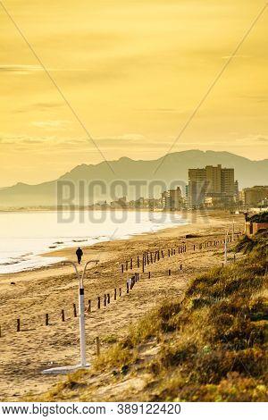 Seascape At Morning, Beach In Gandia. Montgo Mountain Massif Silhouetted On Horizon. Valencia Spain.