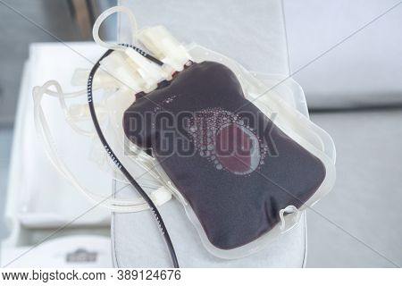 A Plastic Blood Bag On The Table After  Donor Donate Blood For A Community Supply Or To Hospital. Bl