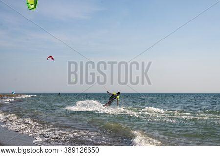 16.9.2020-ada Bojana, Montenegro. Kitesurfing On Sea.   People On Beach Kite Surfing On Windy Day. V