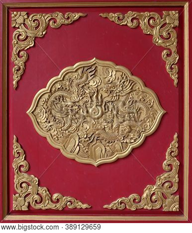 Nonthaburi,thailand July 10, 2017: Golden Wood Carved Of Two Dragon On The Red Wood Of Door At Borom
