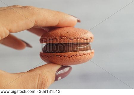 Macaroons. Delicious French Desserts. Macaroons In A Hand. Macaroons With Cherries