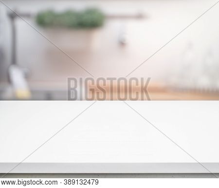 Selective Focus/white Table Top On Blur Kitchen Counter (room)background.for Montage Product Display