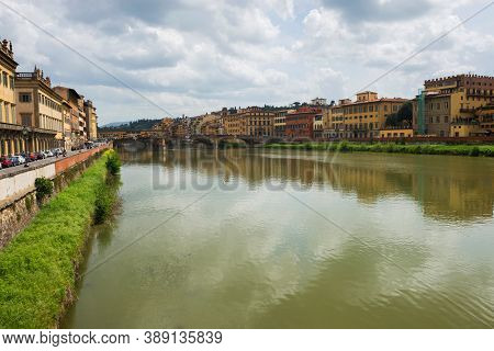 Flornce, Italy - April 24, 2019: View Of The Historic Buildings In Florence. Reflection In The River