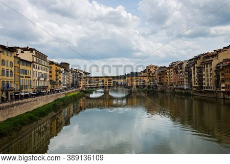 Flornce, Italy - April 24, 2019: Ponte Vecchio. View Of The Historic Buildings In Florence. Reflecti