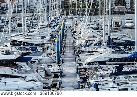 Sanxenxo, Spain - August 18, 2020: Small Sailing Boats Moored In The Yacht Club Of Sanxenxo On A Cle