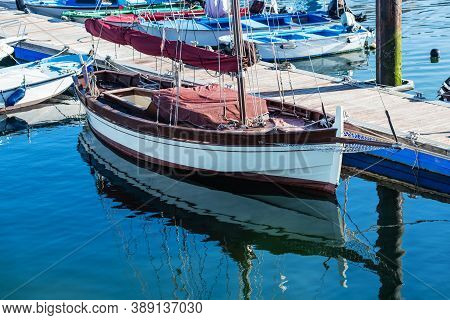 Small Sailing Boats Moored In The Yacht Club Of Portonovo On A Clear Summer Day, Pontevedra, Spain.