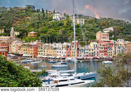 Beautiful Small Village Portofino With Colorfull Houses, Luxury Boats And Yachts In Little Bay Harbo