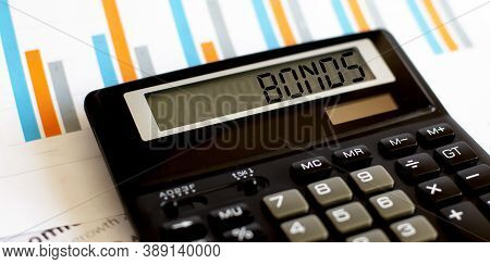 Calculator With The Word Bonds On Display With Chart And Glasses