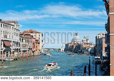 Venice, Italy - July 14, 2016: View From The Bridge To The Grand Canal And Santa Maria Della Salute.