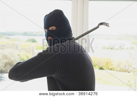 Burgalr swinging crow bar in home