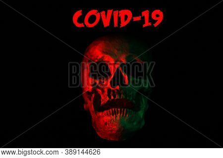 Covid-19 Halloween Human Skull. A Spooky Monstrous Human Skull Isolated on Black. Coronavirus Human Skull in black. Covid-19 text is removable.