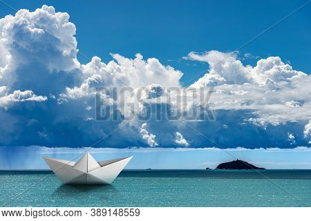 White Paper Boat In The Turquoise Sea Under The Sky With Cumulonimbus And Torrential Rain. Silhouett